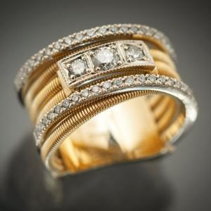 Moderan prsten od žutog zlata sa dijamantima